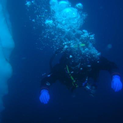 chris thrall diving on iceberg